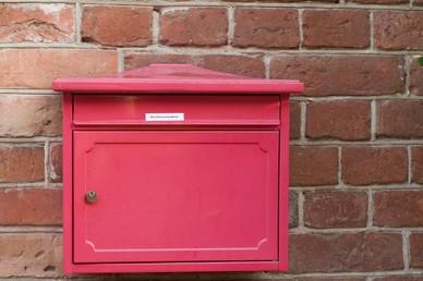 Brick In Letterbox